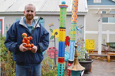 Tim Sullivan, creator of the orange men, poses at his parents' house.