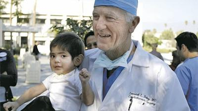 Dr. Leonard Bailey with a patient in 2009.