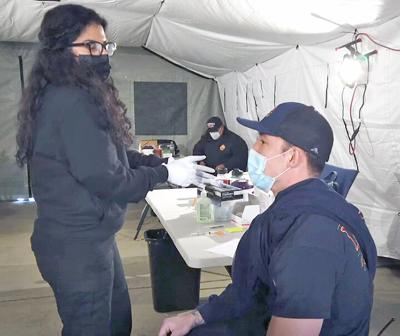 Redlands firefighter among the first to get vaccinated.