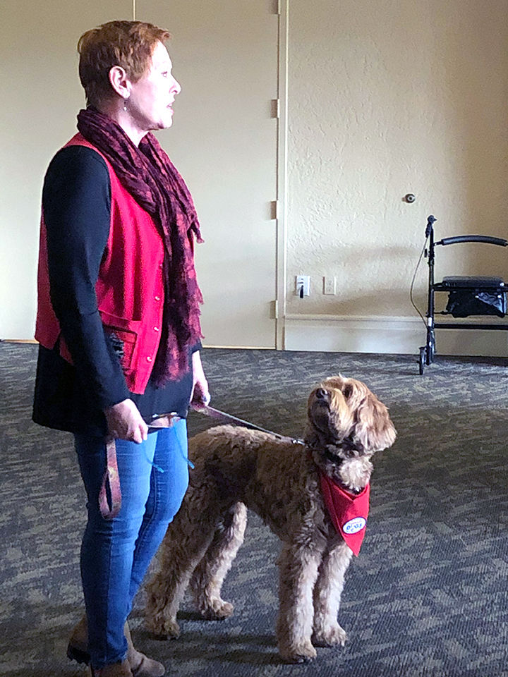 Carolyn Ritchie and her therapy dog, Elliot.