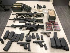 Felon charged with spousal abuse, possession of weapons.