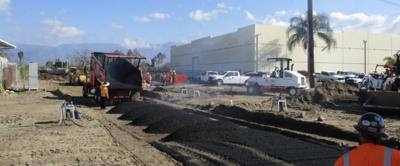 Crews installing sub-ballast at Mill Street preparing the area for new track installation.