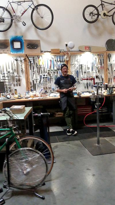 Eric Shamp in his beloved bycycle shop.