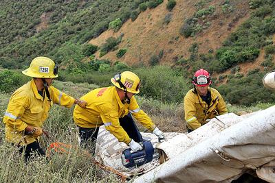 Removing three bodies from a plane crash