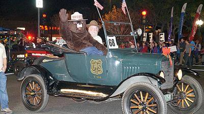 Smokey Bear waves to the crowd at the 2018 Redlands Christmas Parade. Smokey waves to the crowd.