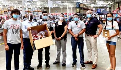 Costco employees wearing their new face shields.