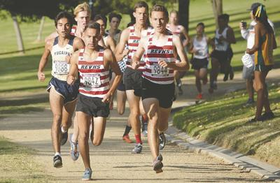REV boys take top five spots to win cross-country title