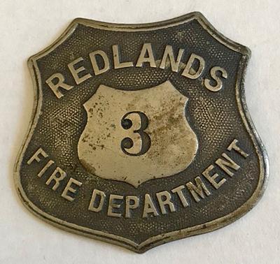 Redlands Fire Department badge No. 3