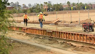 Construction begins on parking garage.