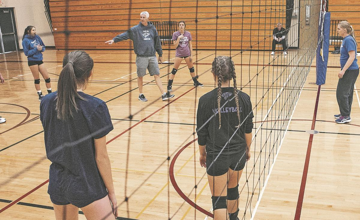 Central Christian volleyball Coach Mike Polk talks to his team during an Oct. 9 practice.