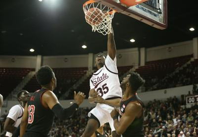 Men's basketball grabs first postseason win since 2010