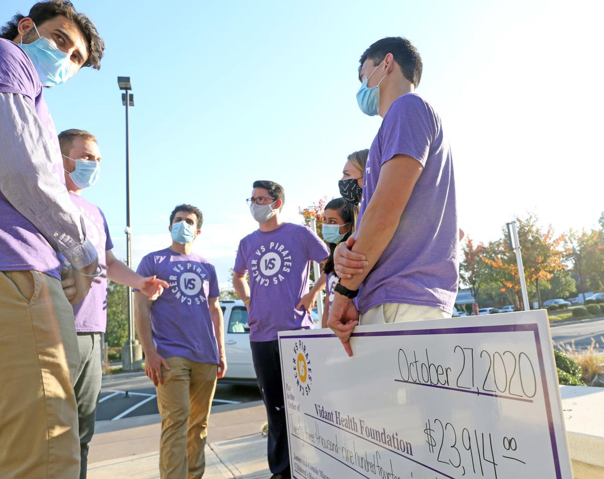 Pirates Versus Cancer presented a check Tuesday 3