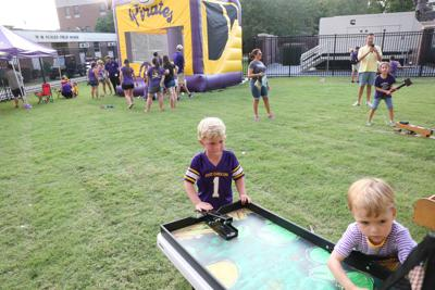 Children play at the new kids zone at Dowdy-Ficklen Stadium