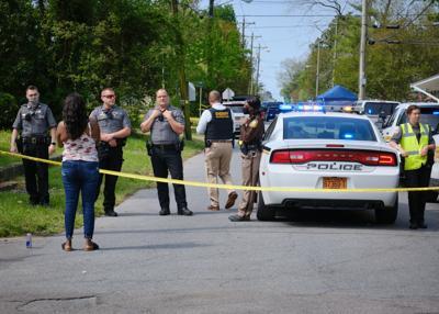 deputies behind crime tape at brown house