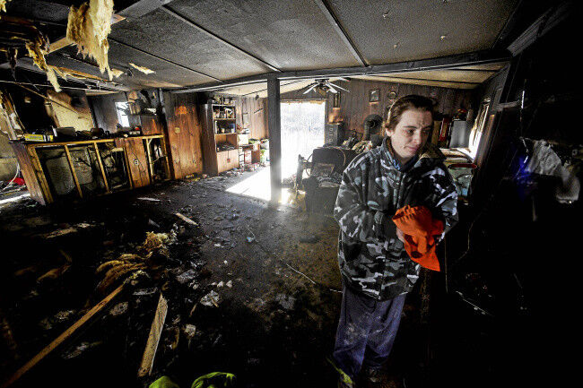 Putney family awakes to infant's cries, home on fire