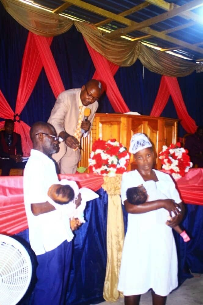 Haitian family receives key to their new home at a special ceremony.jpg