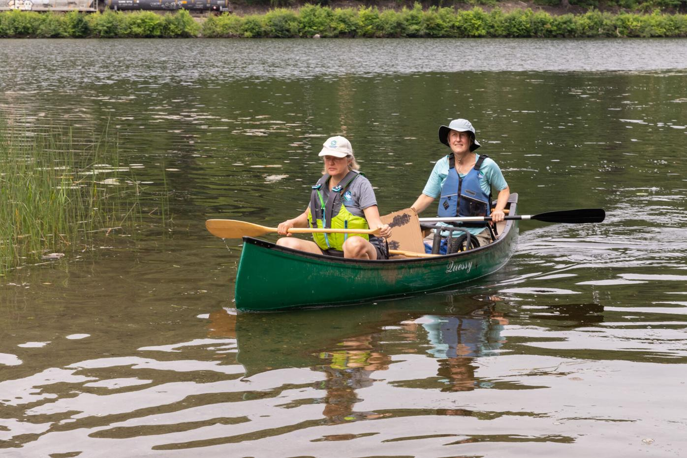 Kathy Urffer, left, and Andrea Donlon, CRC River Stewards, guide their canoe to the Pine Street Boat Launch-6542.jpg