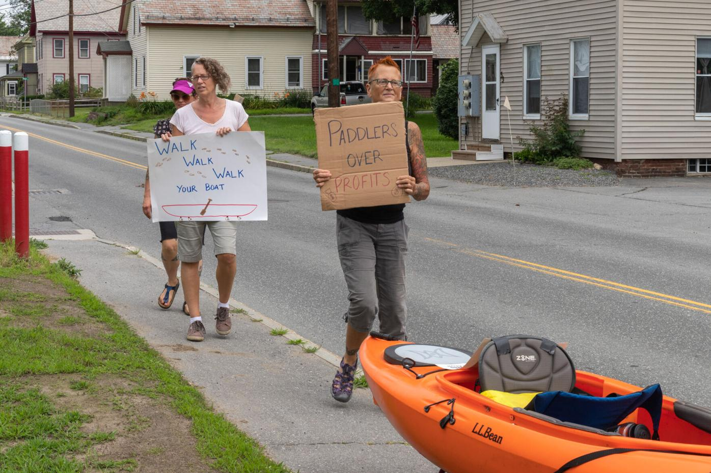 Marchers carry signs in the portage parade along Route 12 in North Walpole-6581.jpg
