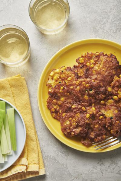 Corn and zucchini fritters on a plate