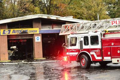 Three-alarm suspicious fire damages Putney business