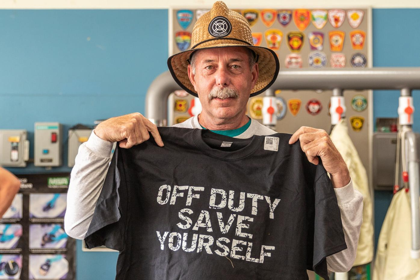 Rick Gauthier wears sun hat and holds up t-shirt presented him by his nephew, New Jersey firefighter Pete Hubert-6758.jpg