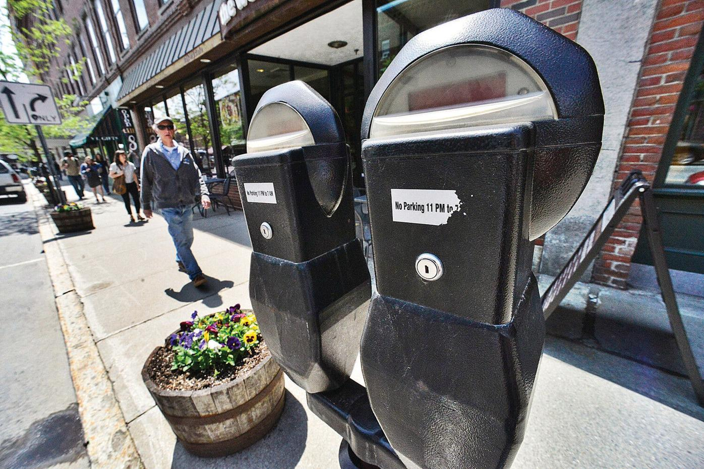 New parking meters would take plastic