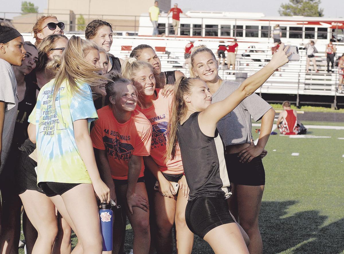 Paola boys, girls sweep regional track titles