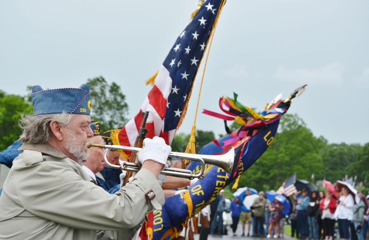 Memorial Day service draws crowd despite wet, windy morning
