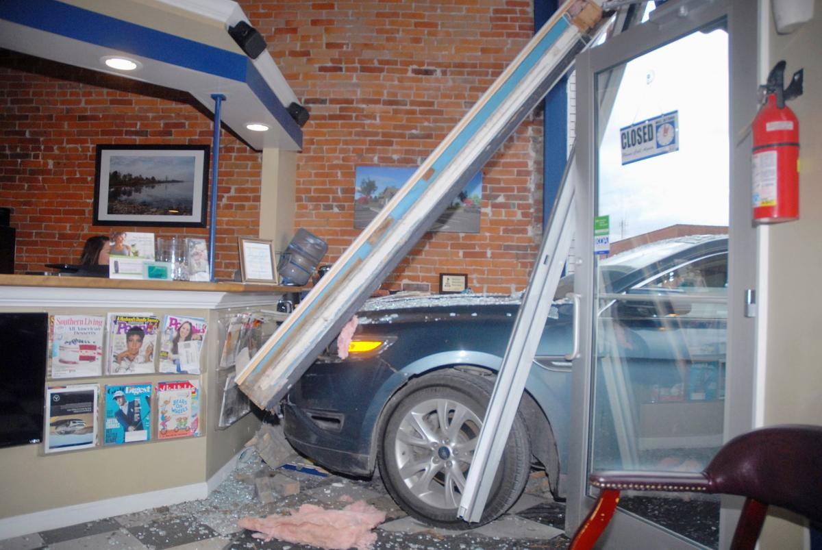 Car plows through front entrance of Paola dentist office