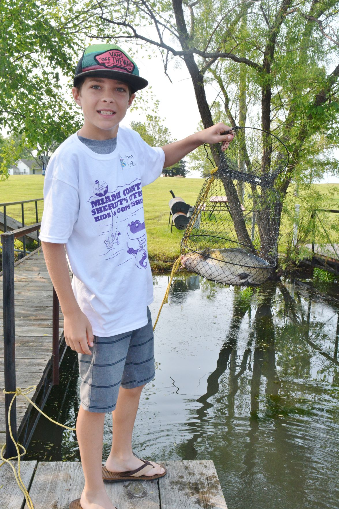 Kids and cops team up for fishing tournament