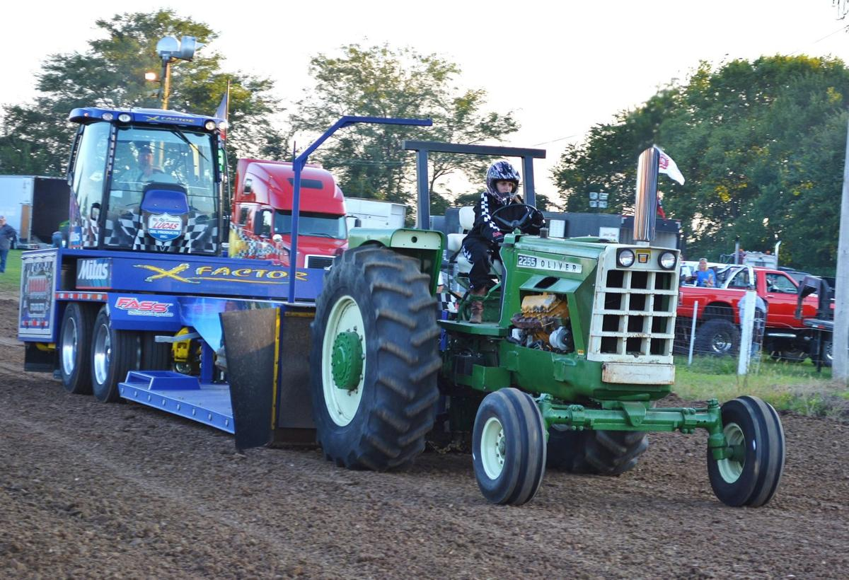 Louisburg tractor pull features antique tractors, modified