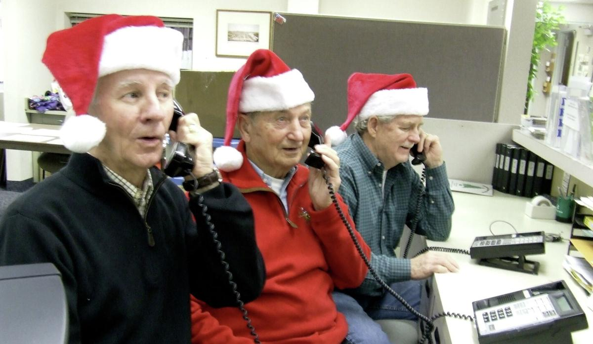 Dean Massett, Dan Mjolsness, Tom Schooley santa phones.jpg