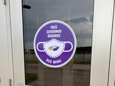 Mask signs on Red Wing High School doors
