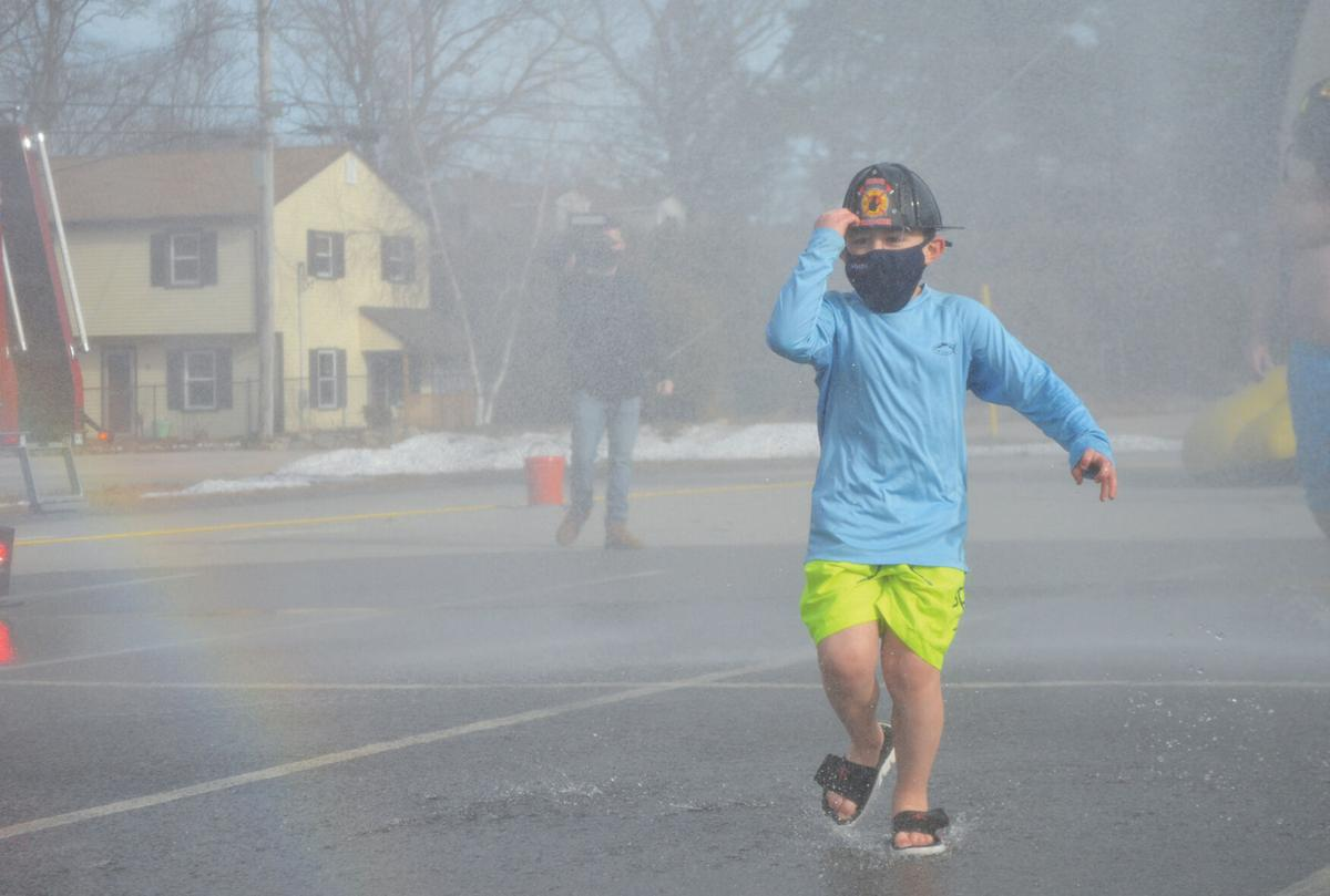 Coventry firefighters plunge to benefit Special Olympics, ring in new year