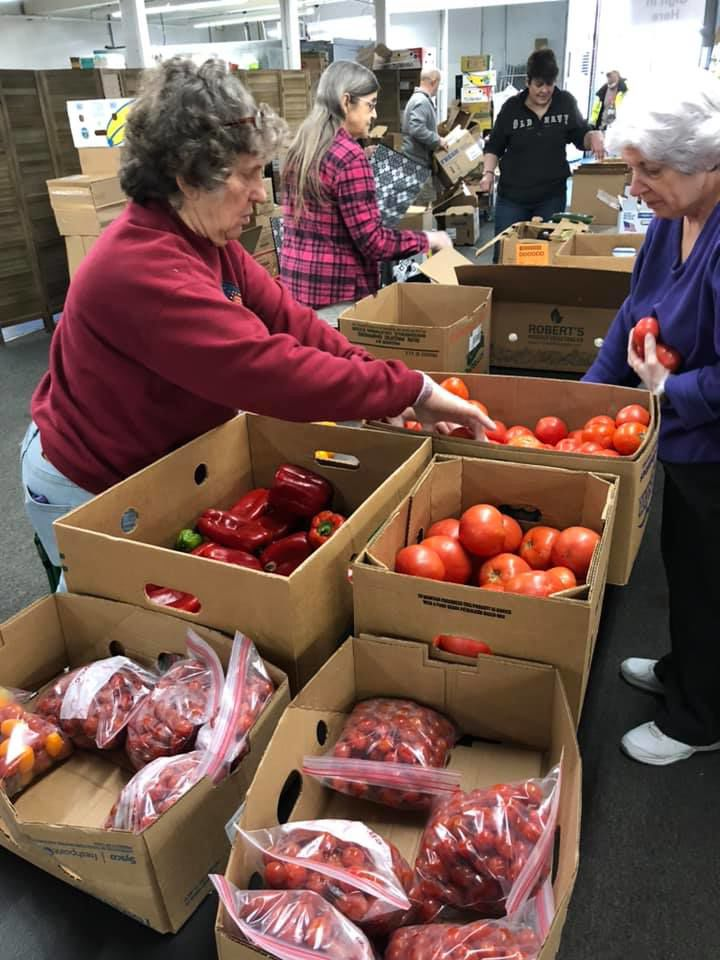 Project Hand Up volunteers working to keep families fed