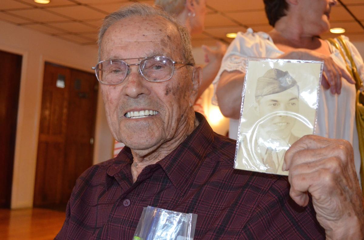 West Warwick native Albert DeSilva celebrates his centennial with family