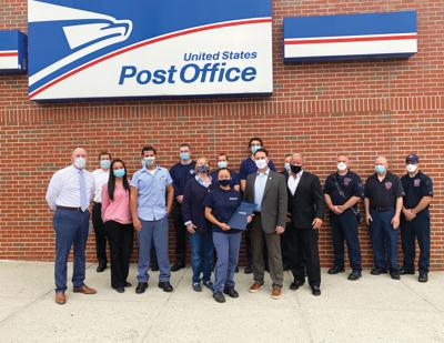Town recognizes USPS employee for response to medical emergency