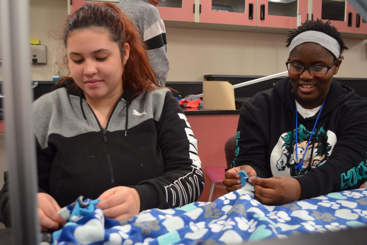 WWHS students make blankets for shelter pups