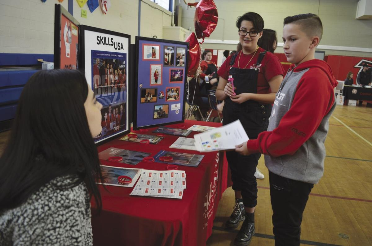 Eighth graders at Alan Shawn Feinstein Middle School learn about programs offered at CHS Career and Technical Center during career fair