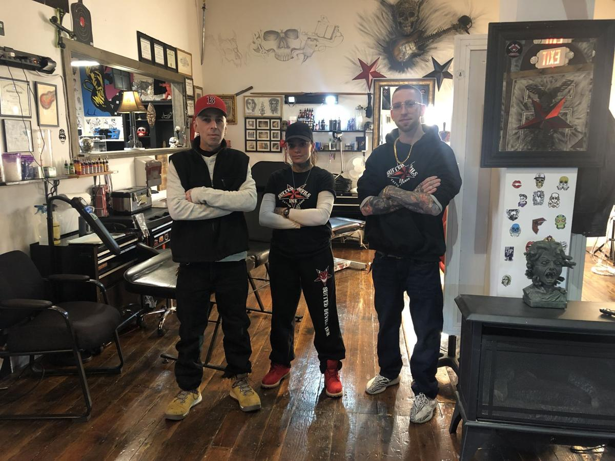 57e5b69cc From left: Suited Devil's Ink Shop Manager/Artist James Grizzo, Piercer  Kellie Kowalski and Tattoo Artist Nick Diamond.