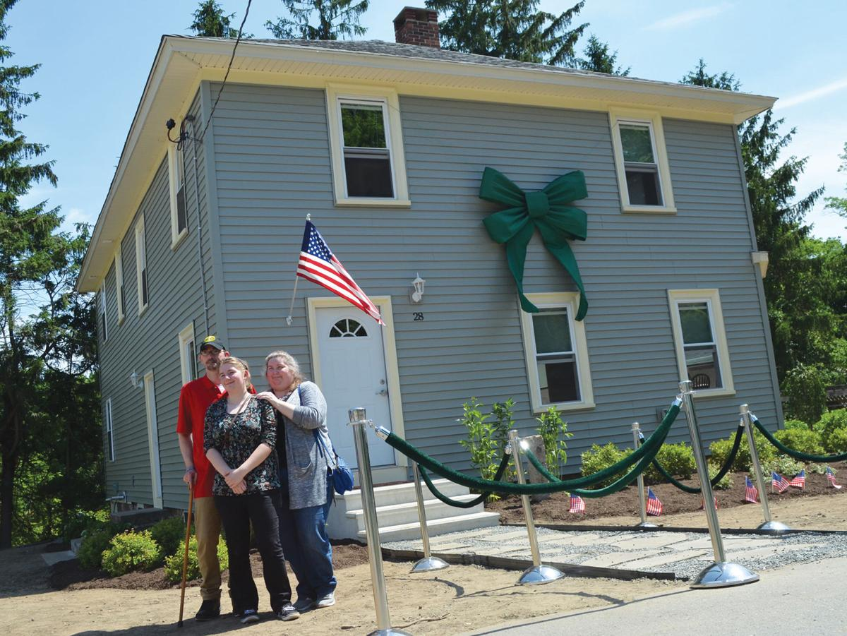 Citizens Bank, national nonprofit award Coventry home to Army veteran