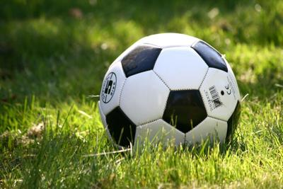 Soccer ball in a field stock photo