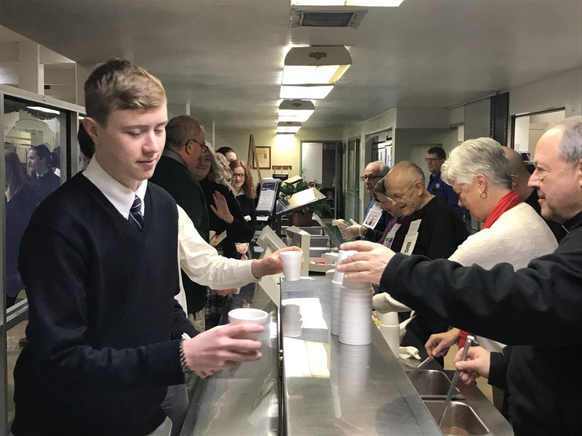 Father Hite serves cocoa