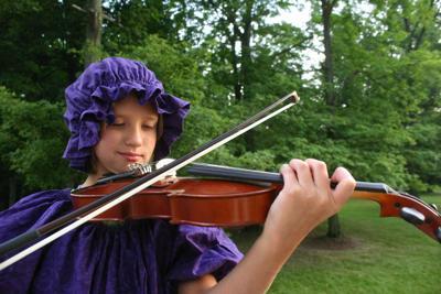 Amelia plays the violin