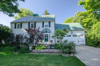 Woodland home offers historic charm and private lot