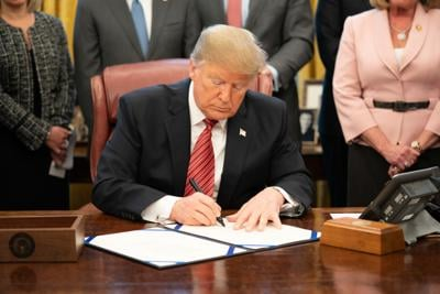 Trump signs $2.2 trillion COVID-19 relief package