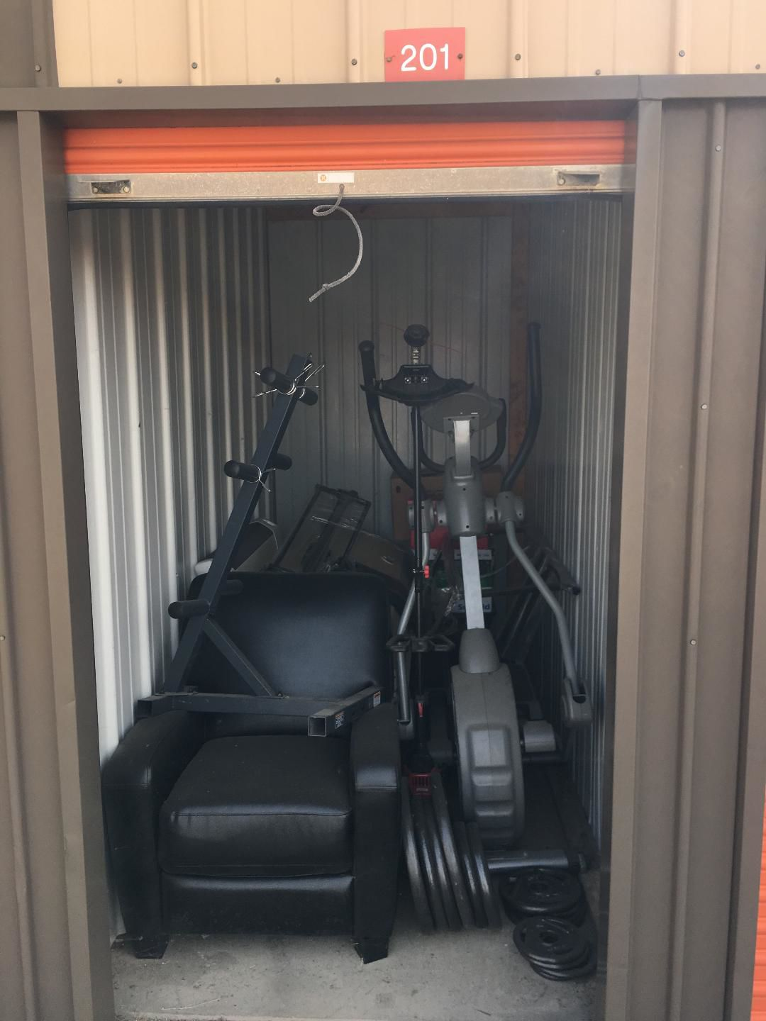 Exercise equipment, tv, motor scooter available at Lock It Up Storage Auctions on May 10