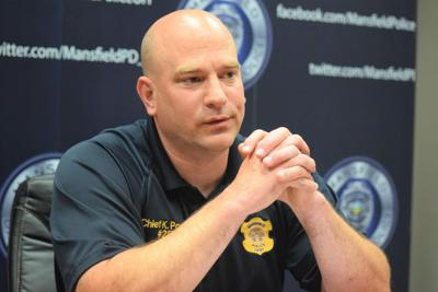 Mansfield police officer on administrative leave after shooting suspect