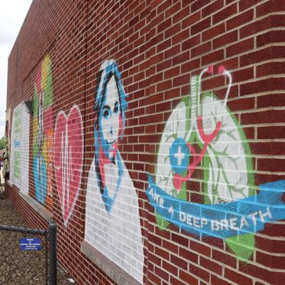 "GALLERY: ""We Flatten The Curve"" mural"