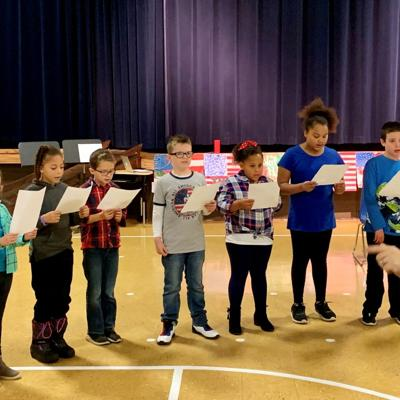 Discovery School students salute veterans